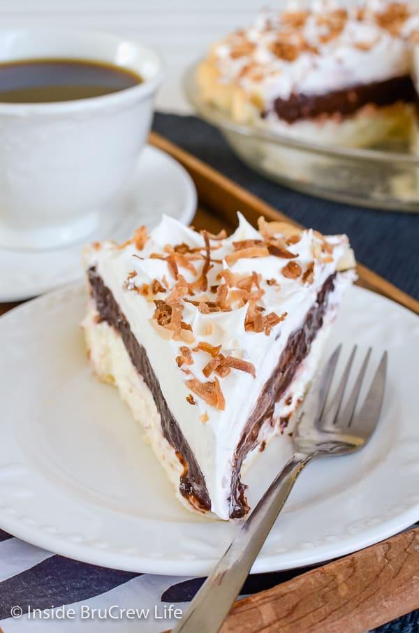 Coconut Fudge Pie - chocolate pudding and coconut cheesecake layers make a delicious pie recipe! Make this easy recipe for dessert! #pie #coconut #coconutcream #chocolate #nobakecheesecake #pudding