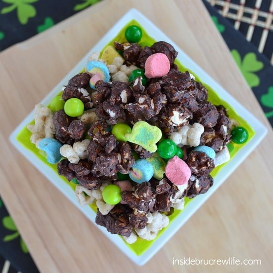 Lucky Charms Chocolate Covered Popcorn - Chocolate covered popcorn mixed with Lucky Charms cereal and candy is a fun treat for movie night. It will disappear in a hurry!