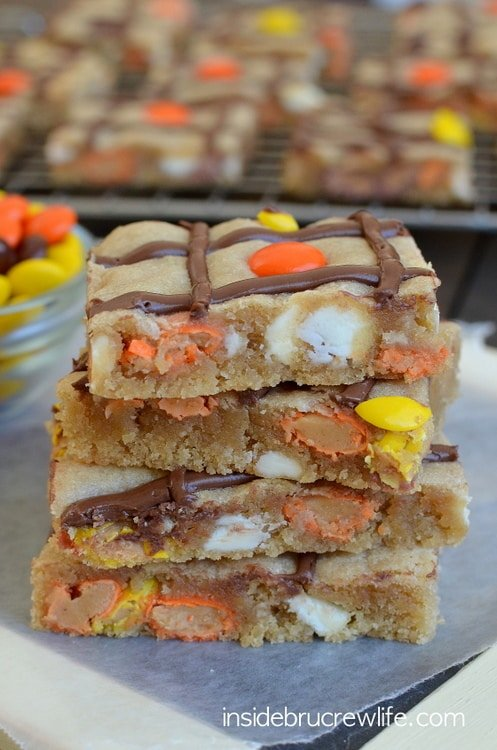 Peanut Butter Nutella Cookie Bars - easy cookie bars loaded with white chocolate, Reese's pieces, and Nutella. Great recipe when you need a sweet treat.