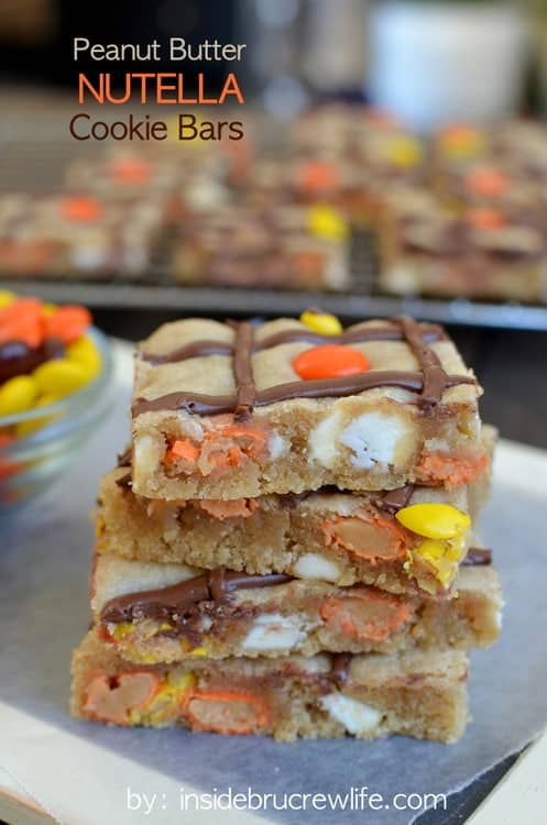 Peanut Butter Nutella Cookie Bars - peanut butter cookie bars with a swirl of Nutella and Reese's pieces. Easy bar cookie recipe when you need a sweet treat.