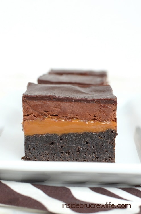 Chocolate and caramel layers add a decadent and delicious flair to homemade brownies.