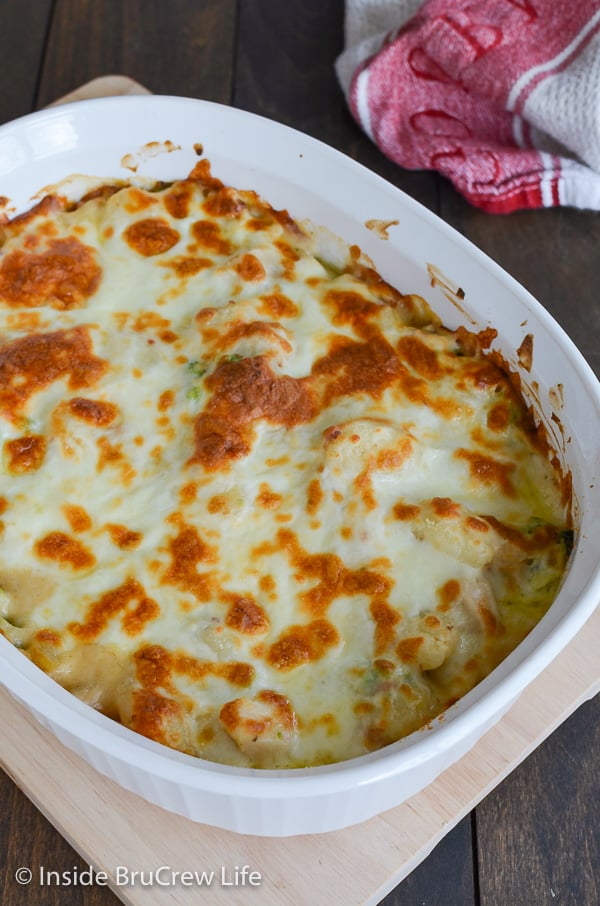 An overhead picture of a white casserole dish filled with loaded chicken alfredo gnocchi bake