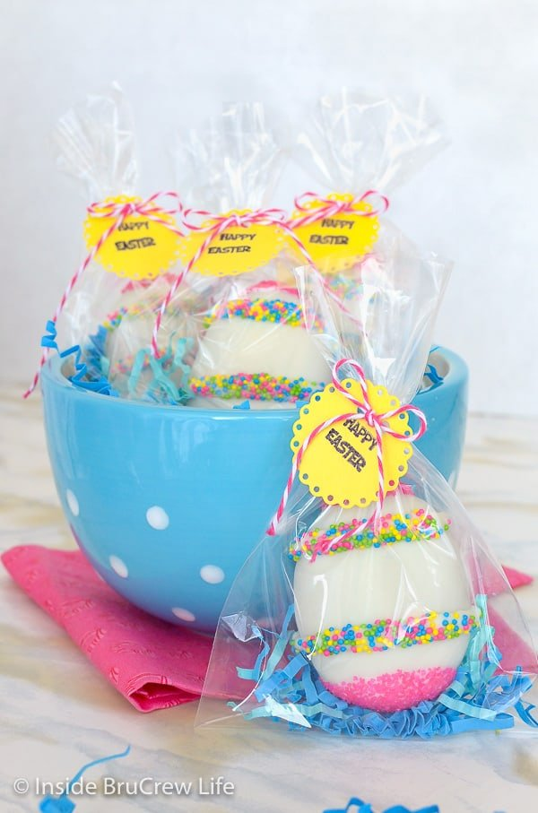 A blue bowl with Nutella cream eggs wrapped in cellophane bags with a yellow tag