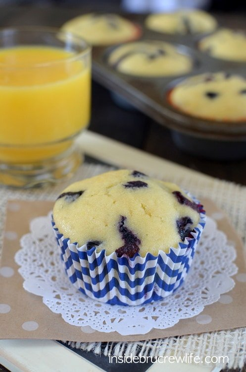 These light and fluffy orange muffins are filled with lots of fresh, juicy blueberry bites.  Perfect morning breakfast choice!