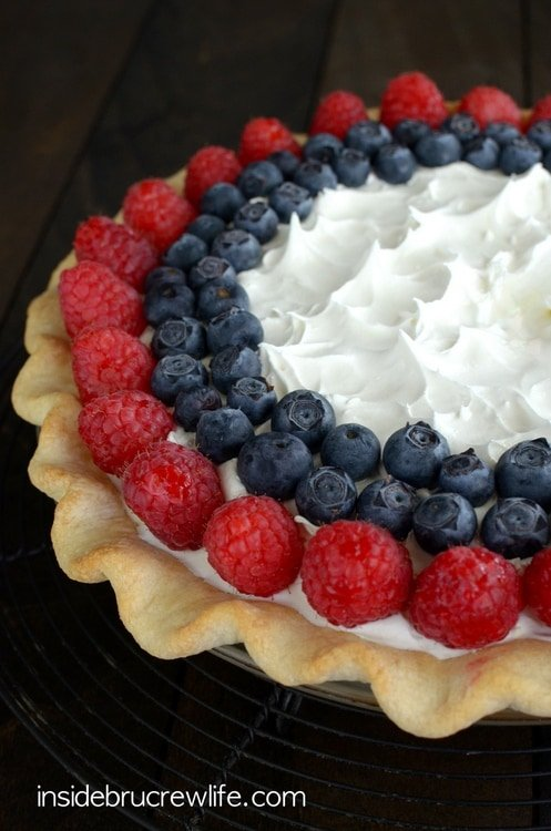 Layers of no bake cheesecake, lemon pudding, and berries makes this a delicious and pretty pie