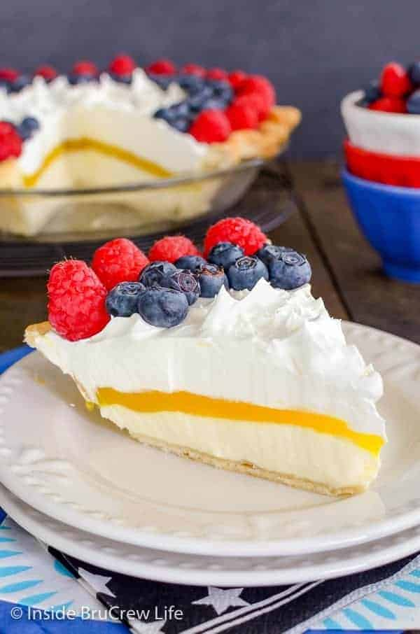 Lemon Cream Berry Pie - layers of no bake cheesecake, lemon pudding, and berries make this a delicious and pretty pie. Make this recipe for summer picnics and parties. #lemoncream #pie #nobakecheesecake #fourthofjuly #summerdessert