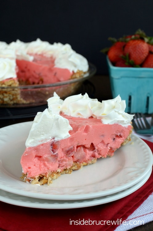 This easy NO BAKE pie has a sweet and salty pretzel crust and a strawberry filling that tastes so good.