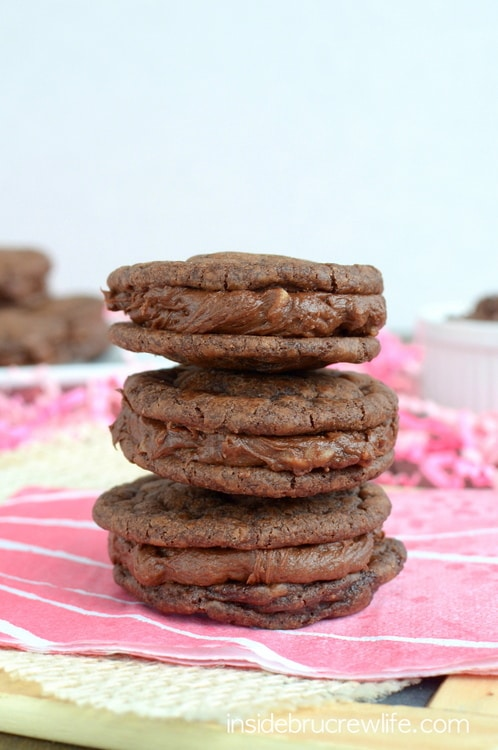 Easy brownie cookies filled with a chocolate toffee frosting...you might not want to share these bad boys!