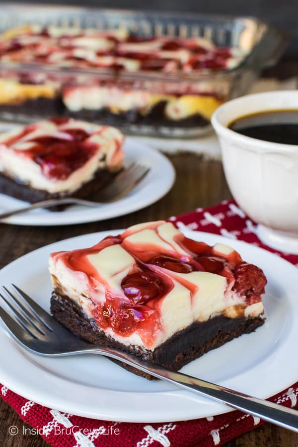 Cherry Cheesecake Brownies - layers of brownies, cheesecake, and pie filling creates an amazing dessert. Easy recipe for parties! #cheesecake #brownies #cherry #holiday #dessert #easyrecipe #piefilling