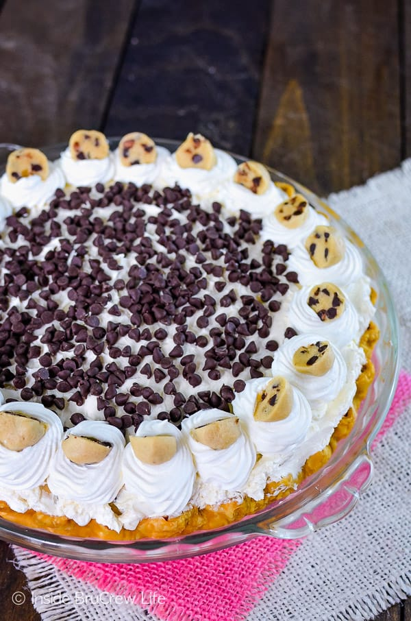 Cookie Dough Cheesecake Brownie Pie - little cookie dough bites inside a creamy cheesecake turn this brownie pie into an amazing dessert. This is a must make recipe for parties! #browniepie #cookiedoughbites #nobakecheesecake #bestdessert #cheesecakelove