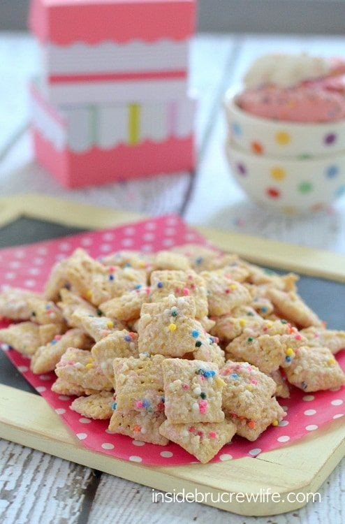 Frosted Animal Cookie Muddy Buddies - crushed animal cookies and chocolate coat this easy muddy buddies snack mix