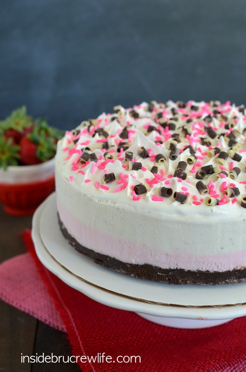 Vanilla and strawberry ice cream layered on a chocolate brownie makes a great summer cake.