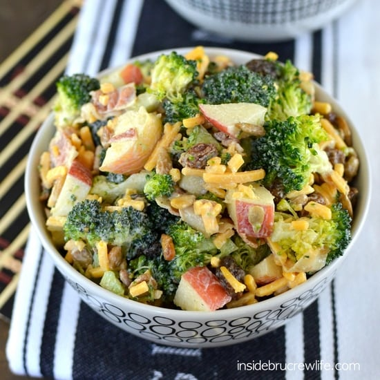 Healthy broccoli salad, with cheese, bacon, apples, and raisins