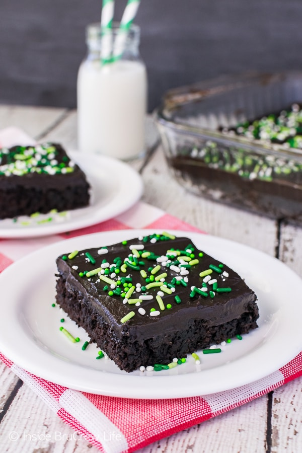 Dark Chocolate Zucchini Cake - chocolate frosting and sprinkles add a fun flair to this easy and delicious cake! Great recipe to make for parties and picnics!