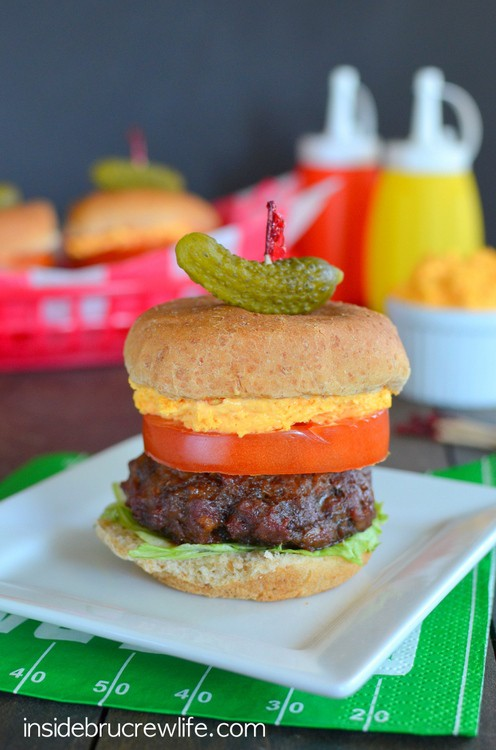 Cheese, bacon, and ranch added to beef makes the perfect mini slider for tailgating or grilling out parties.