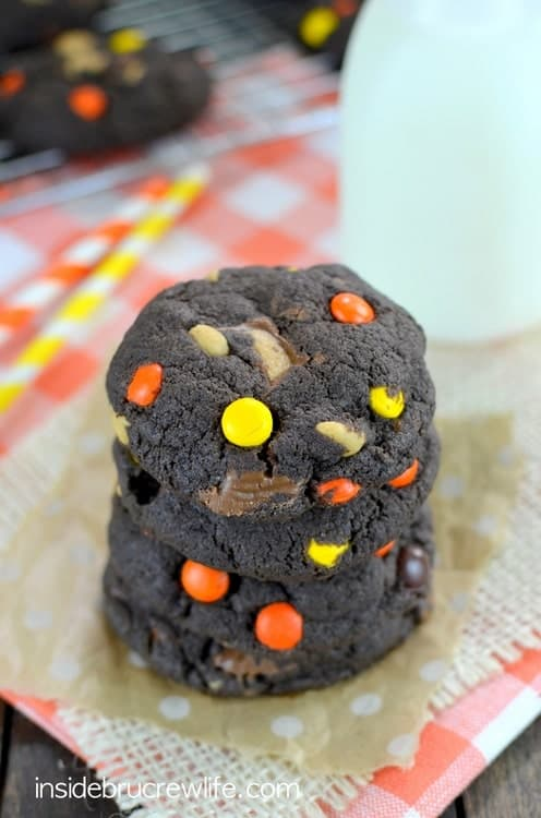 Chocolate Reese's Cookies - these easy chocolate mix cookies are loaded with three kinds of Reese's. Make this recipe and watch them disappear! #cookies #cakemixcookies #reeses #peanutbuttercups