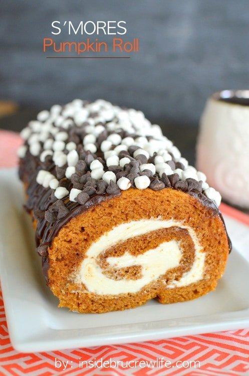 S'mores Pumpkin Roll - chocolate drizzles and marshmallow frosting adds a delicious flair to the classic pumpkin roll. Easy recipe to make this fall. #pumpkin #cakeroll #fall #smores #thanksgiving