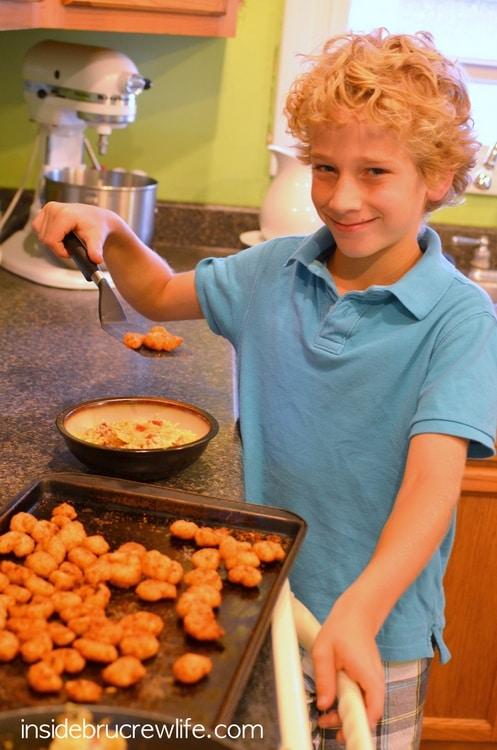 Kids helping to serve Bacon Shrimp Alfredo