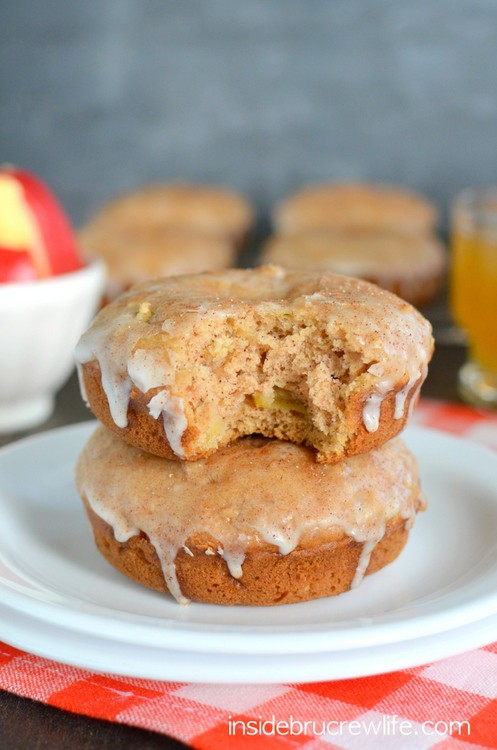 These easy homemade donuts have lots of fresh apples and apple cider baked into them.  The glaze and cinnamon topping puts them over the top!