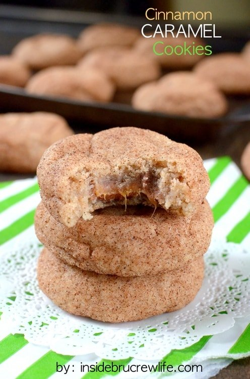 Cinnamon Caramel Cookies - these soft puffy cookies have a caramel candy bar inside and cinnamon sugar outside. Easy recipe to fill your cookie jar with!