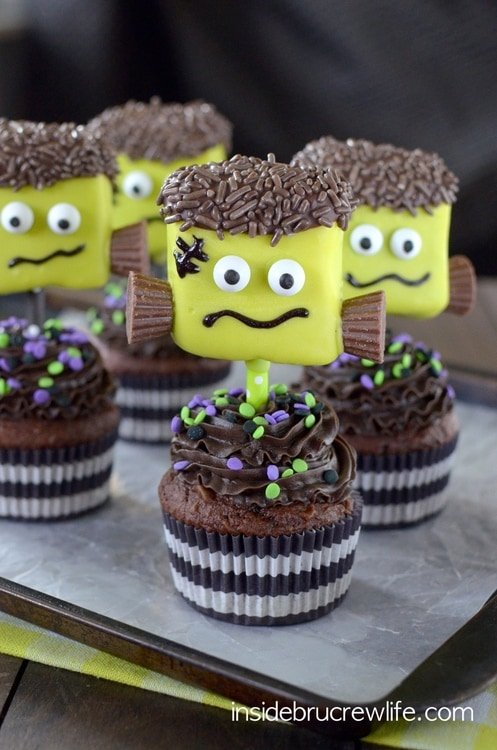 Marshmallows dipped in green melting chocolate, googly eyes, and Reese's make cute Frankenstein marshmallows.
