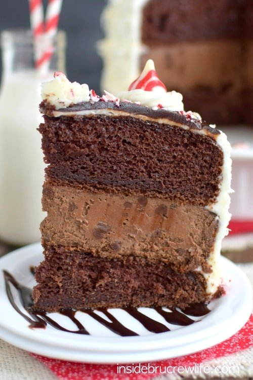 Candy Cane Chocolate Cheesecake Cake - layers of chocolate cheesecake and cake with peppermint frosting is one holiday dessert you have to make this year! Great recipe for holiday parties!