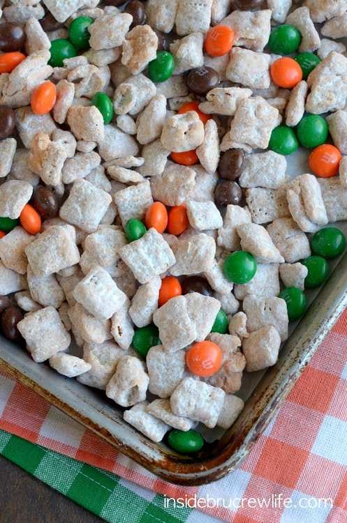 Cinnamon Pumpkin Spice Muddy Buddies - pumpkin spice chocolate and fall colored candies make this snack mix so easy. Great no bake recipe for fall munching!