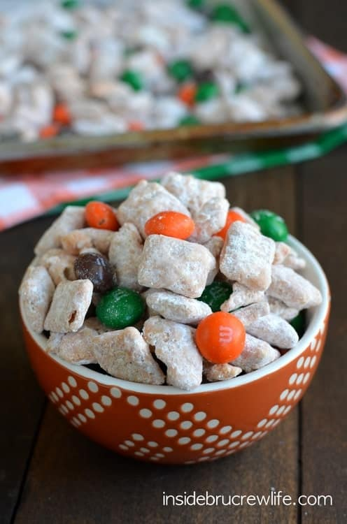 Cinnamon Pumpkin Spice Muddy Buddies - sweet no bake chex mix coated in pumpkin spice chocolate. This easy snack mix is perfect for fall munching!