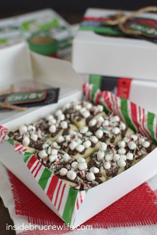 Layers of hot chocolate fudge mixed with candy canes and marshmallows is such a pretty dessert for holiday parties