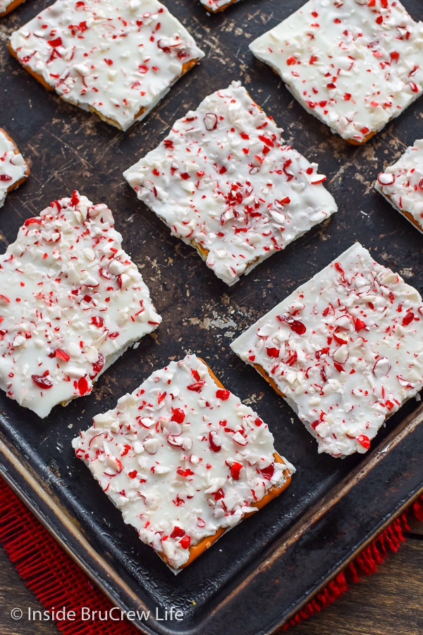 A metal tray with squares of candy cane pretzel bark on it