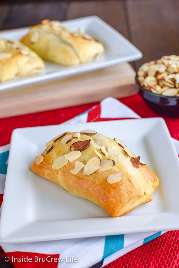 Cherry Almond Brie Bites - crescent roll bites filled with cherry preserves and melted brie cheese. Easy recipe to make for parties or game days. #cherry #brie #appetizers #gameday #partyfood