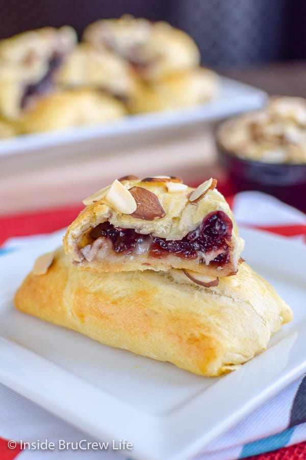 Cherry Almond Brie Bites - homemade cherry preserves and melted brie cheese inside crescent roll pockets is a great appetizer for parties and game days. #cherry #brie #appetizers #gameday #partyfood