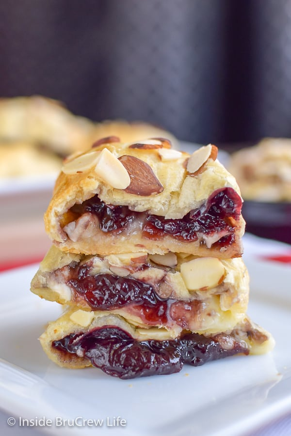 Cherry Almond Brie Bites - these crescent roll bites are filled with a homemade cherry filling and brie cheese. Delicious appetizer for any party or game day! #cherry #brie #appetizers #gameday #partyfood