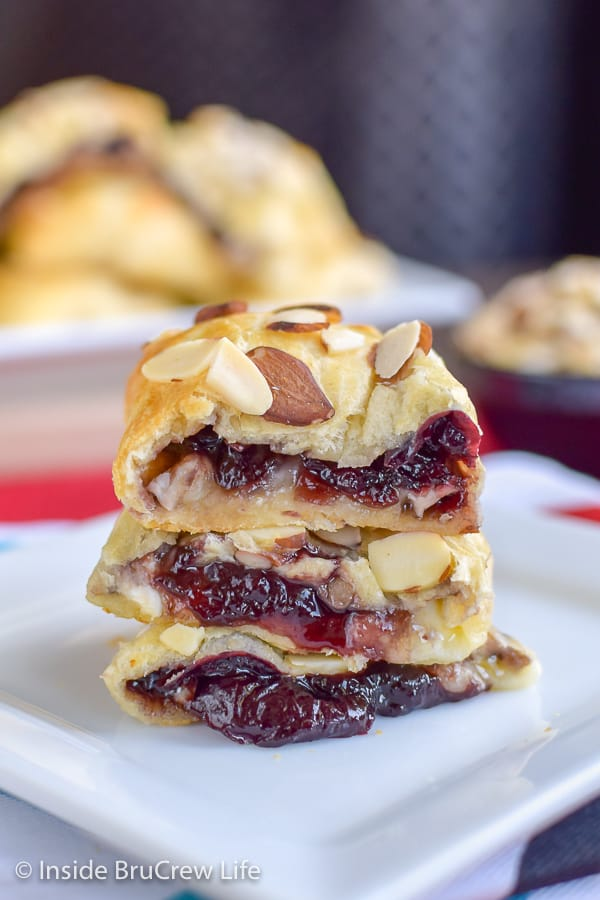 Cherry Almond Brie Bites - homemade cherry preserves and melted brie cheese inside crescent roll bites. Easy recipe to make for game days or parties. #cherry #brie #appetizers #gameday #partyfood