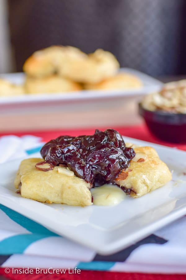 Cherry Almond Brie Bites - melted brie cheese and cherry preserves are delicious inside crescent roll bites. Easy recipe to make for parties or game days. #cherry #brie #appetizers #gameday #partyfood