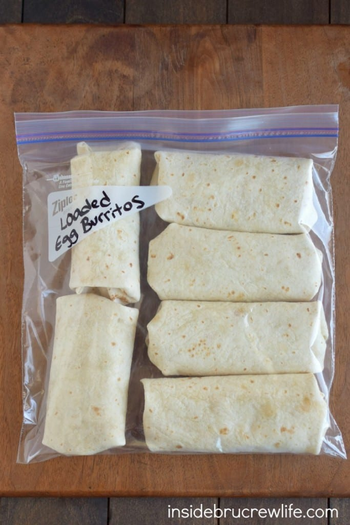 Loaded Egg Burritos - fill your freezer with a batch of easy egg burritos. This is a great recipe to heat up on busy mornings.
