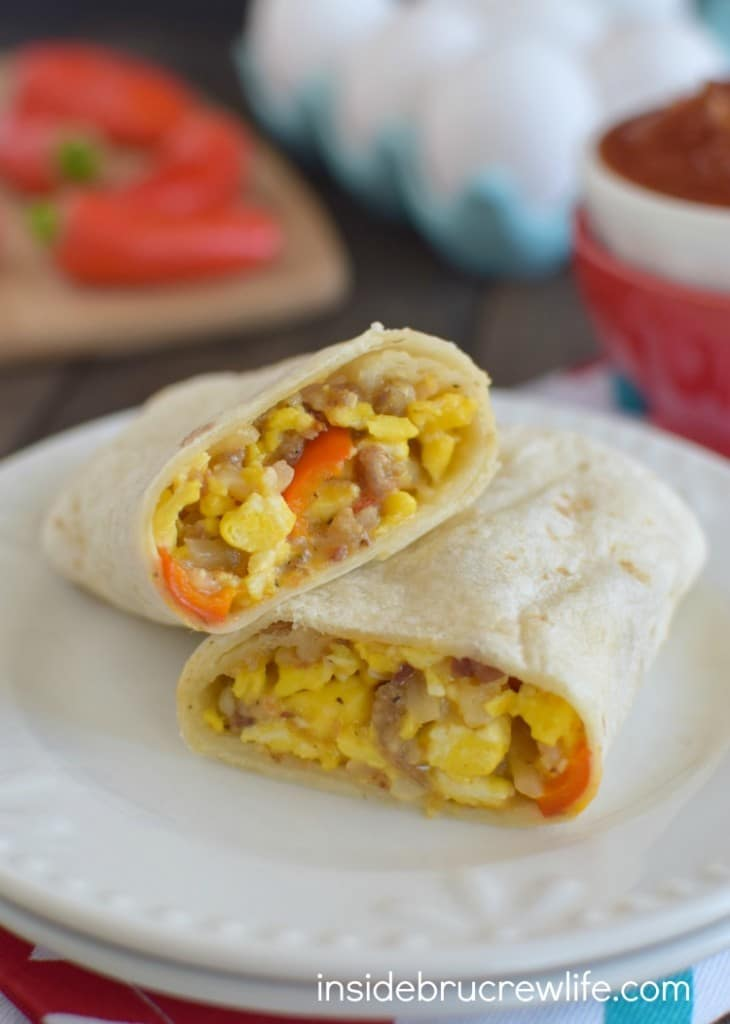 Loaded Egg Burritos - these easy egg burritos are the loaded with meat, veggies, and cheese. Freeze a batch of breakfast burritos for a quick and easy breakfast on busy mornings.