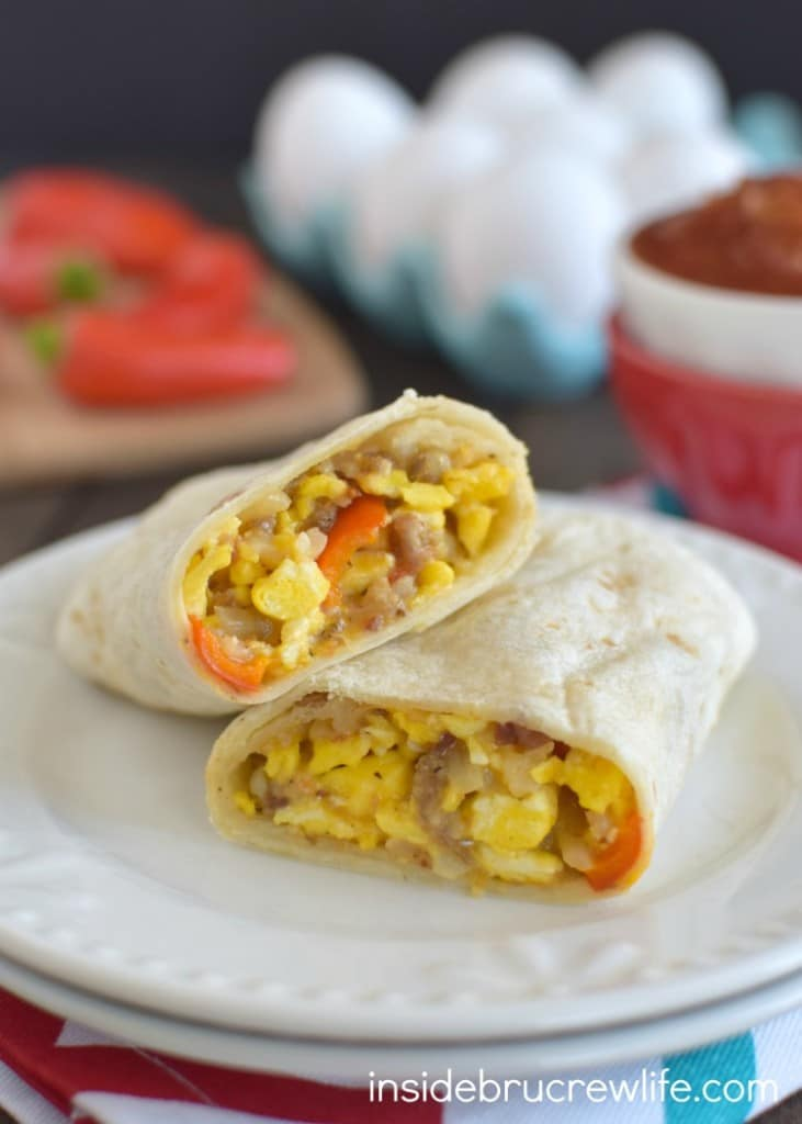 Loaded Egg Burritos - eggs, cheese, sausage, and veggies make the best freezer burritos. Fill your freezer with a batch of this easy recipe for busy mornings.