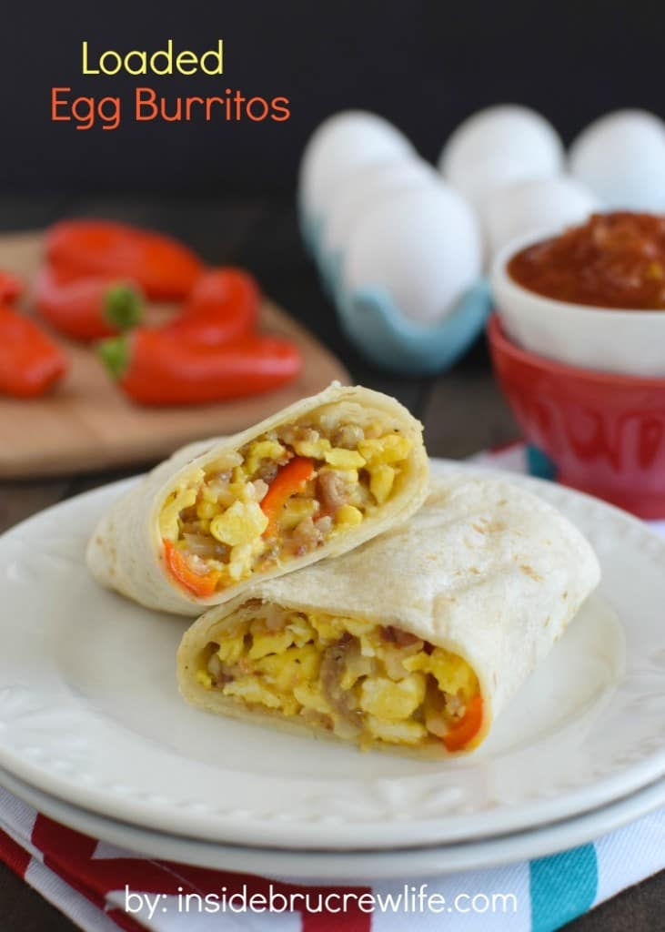 Loaded Egg Burritos - these scrambled egg burritos are loaded with meat, veggies, and cheese for a filling and easy breakfast. Make a batch of freezer burritos for busy mornings.