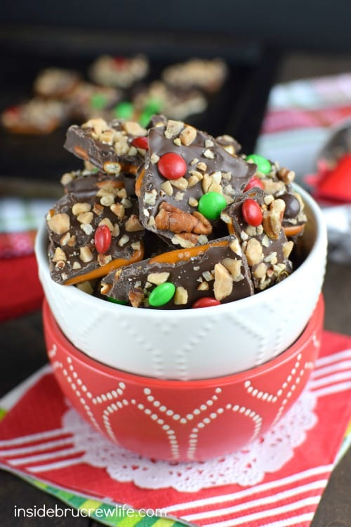 Chocolate covered pretzel bark topped with pecans, toffee, and M&M's ...