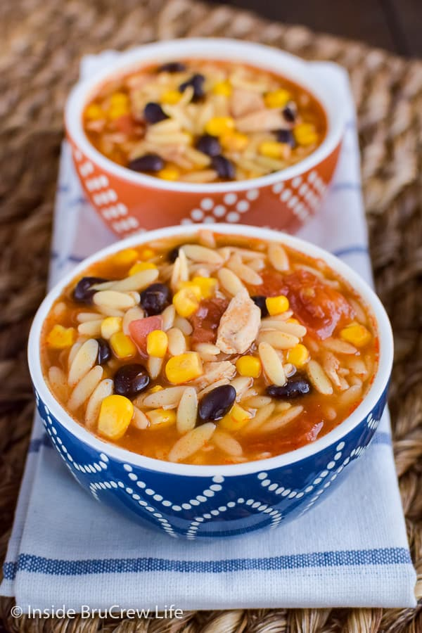 Easy Chicken Enchilada Soup - a pot of this easy soup is loaded with chicken, veggies, and pasta. Make this recipe for dinner and enjoy comfort food in minutes. #dinner #soup #chickenenchilada #chicken #comfortfood