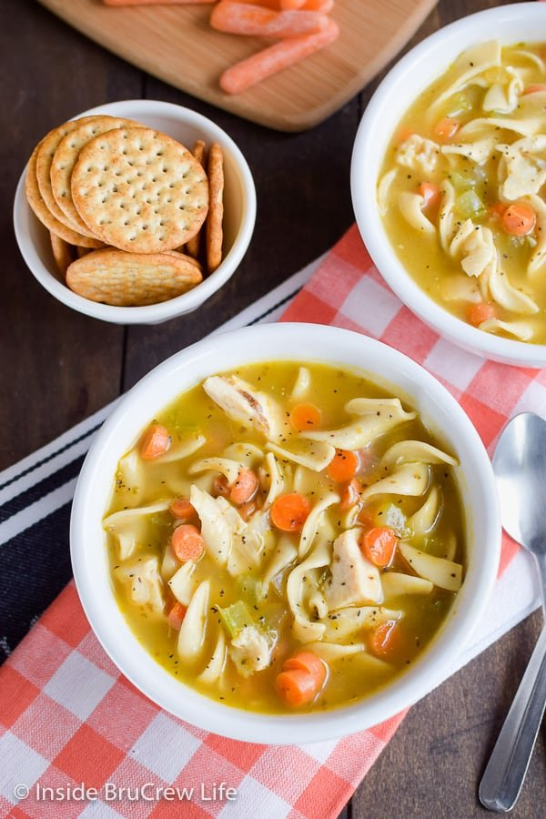 Easy Chicken Noodle Soup - this easy comfort food soup is loaded with noodles, chicken, and veggies and can be on your dinner table in 30 minutes. Great dinner recipe to make for cold days! #soup #chickennoodle #homemade #easydinner #30minutemeal #chickendinner #comfortfood