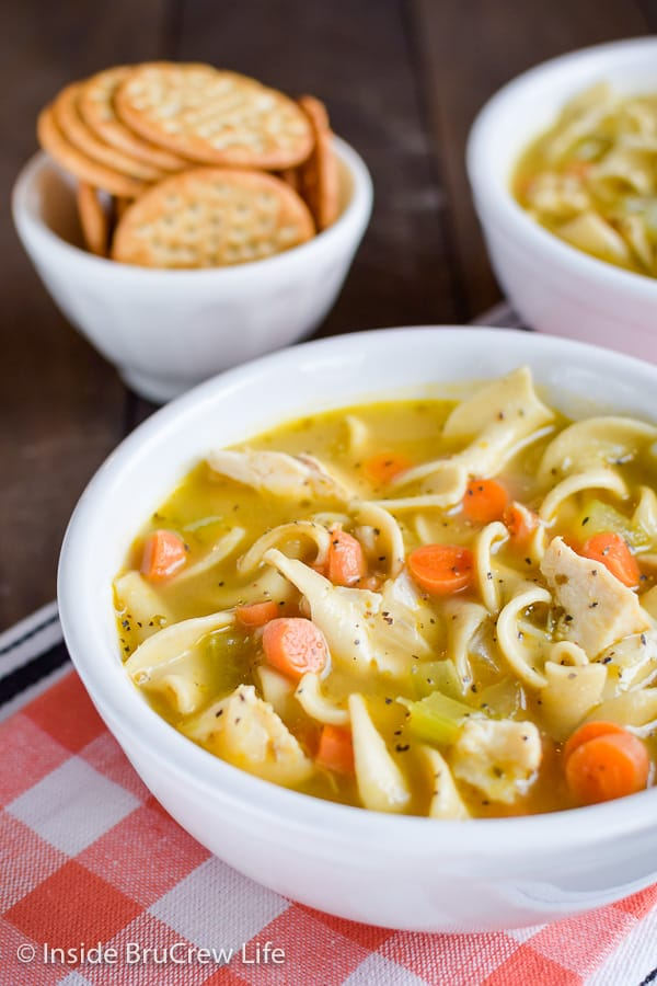 Easy Chicken Noodle Soup - make and enjoy this easy homemade soup in under 30 minutes. This comfort food meal is loaded with veggies, chicken, and pasta and tastes great! #soup #chickennoodle #homemade #easydinner #30minutemeal #chickendinner #comfortfood