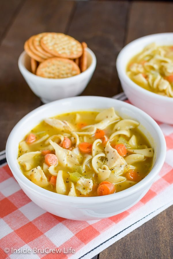 Easy Chicken Noodle Soup - a pot of homemade soup loaded with noodles, chicken, and veggies makes a great dinner on cold nights! #soup #chickennoodle #homemade #easydinner #30minutemeal #chickendinner #comfortfood