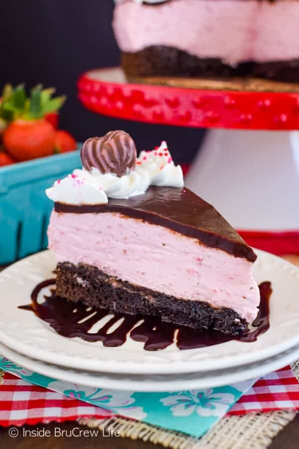 Strawberry Mousse Brownie Cake - layers of homemade brownies and fluffy strawberry mousse make this easy cake an impressive dessert. Make this recipe when you need chocolate and strawberry in your life. #cake #brownie #strawberry #valentinesday #recipe #chocolate