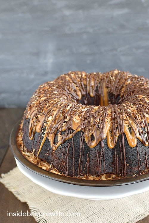 Chocolate and caramel drizzles turn this Chocolate Coconut Cake into a dessert master piece. It is absolutely amazing!