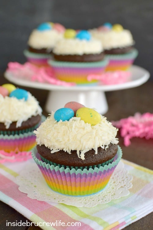 Chocolate cupcakes with marshmallow coconut frosting is a delicious Easter treat.
