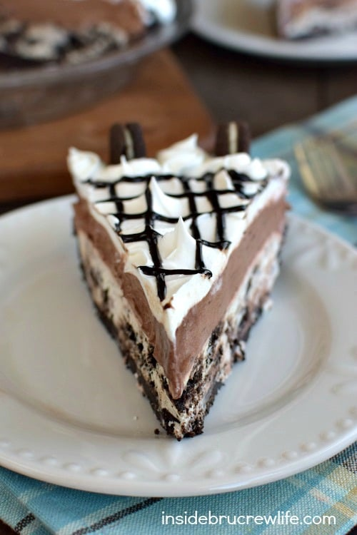 Cookies and Cream Chocolate Pie - this easy pudding pie has a layer of cookies and cream cheesecake on the bottom. Try this easy recipe the next time you need to bring dessert!