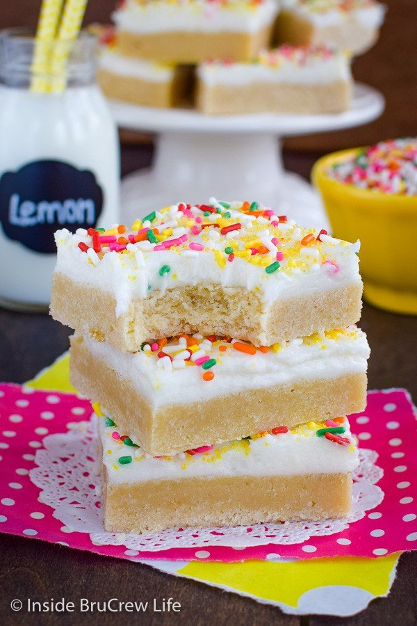 Lemon Sugar Cookie Bars - these easy lemon bars have lemon in the cookie layer and in the frosting making them so light and refreshing. Make this easy recipe for parties and events! #sugarcookiebars #lemonbars #lemoncookies #lemonfrosting #homemade #easydessert