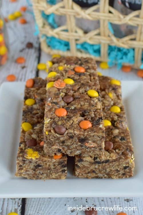 Peanut butter, chocolate cookies, and candy make these no-bake bars a delicious treat to enjoy any time of day.